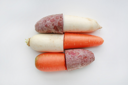 Cut half of fresh carrot, radish and sweet potato on white background.