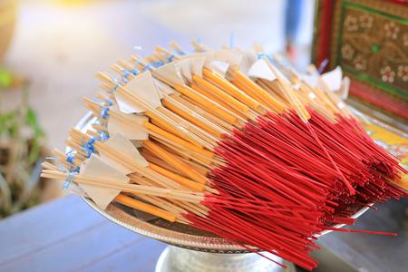 Incense sticks put together candle for praying buddha. Imagens