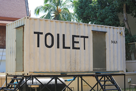 Simple mobile container toilet use during events. Outdoor portable WC.