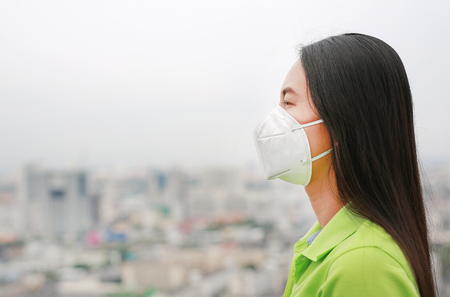 Asian woman wearing a protection mask against PM 2.5 air pollution in Bangkok city. Thailand. Standard-Bild - 121951855