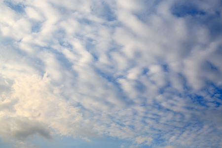 Abstract shape of white cloud on blue sky background.