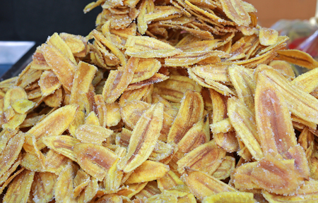 Fried thinly sliced banana chips with sugar.