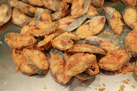 Fried dried fish sliced.