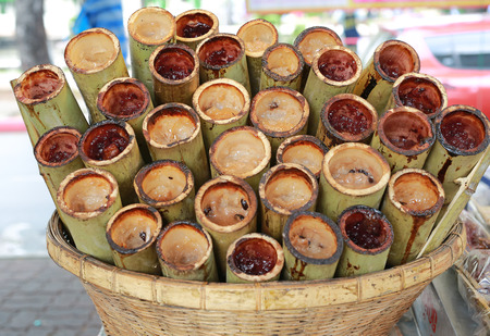 Lemang traditional thai food made of glutinous rice pack up in bamboo.