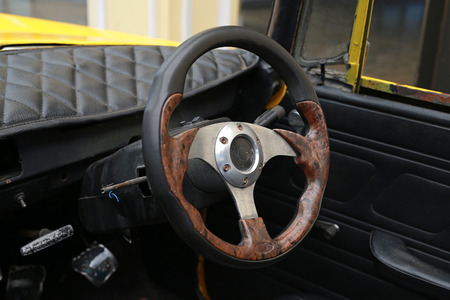 Steering wheel of old rusted car.
