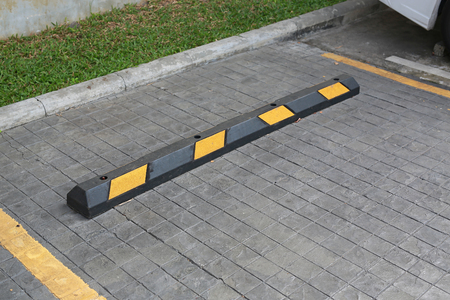 Bumps barrier for reduce car speed when parking. 版權商用圖片