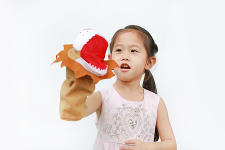 Cute Little Asian child girl hand wearing and playing Lion puppets on white background, Lion head.