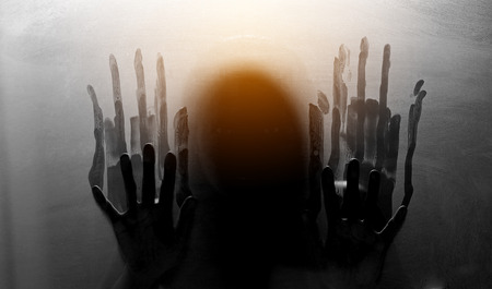 Person shadows on Frosted glass - violence concept background