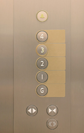 Elevator buttons on panel with blank label.