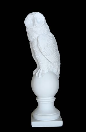 Sculpture of white owl isolated on black background
