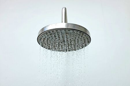 close up on head shower while running water.