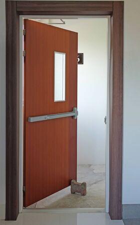 Opened emergency exit door. Stock Photo