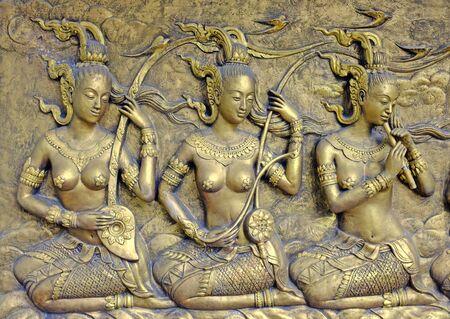 Native culture Thai sculpture on the temple wall Standard-Bild