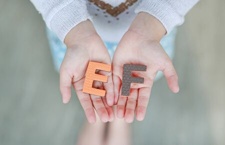 EF (Executive Functions) sponge text on child hands. Education and development concept. Stock Photo