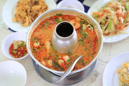 Thai spicy Tomyam soup in hot pot. Stock Photo