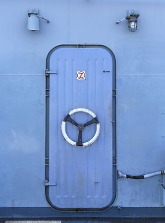 Steel door in the battleship Stock fotó