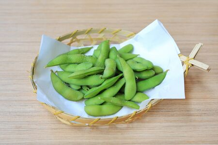 Edamame nibbles, boiled green soy beans, Japanese food