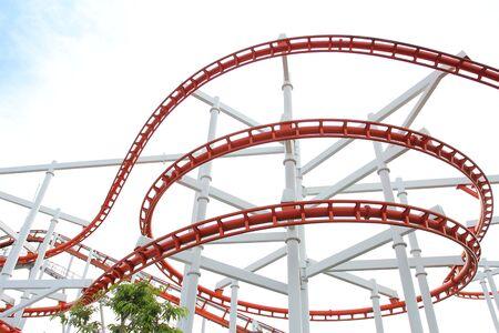 Roller coaster track on white sky background.