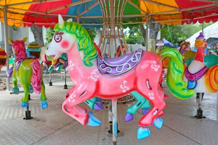 Horses on a carnival Merry Go Round in temple fair