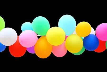 colorful Balloon isolated on black background. Imagens