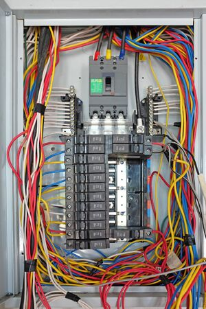 Control panel with circuit-breakers and tangled cable leads