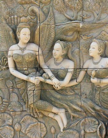 Woman statue thai art in thai temple Stock Photo