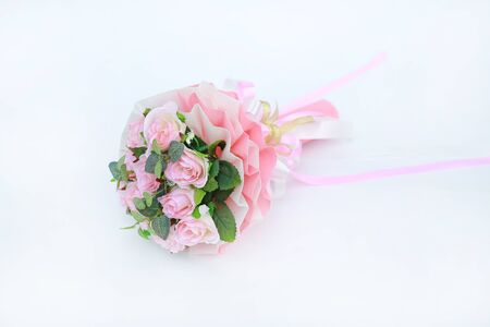 Artificial pink roses bouquet isolated on white background.