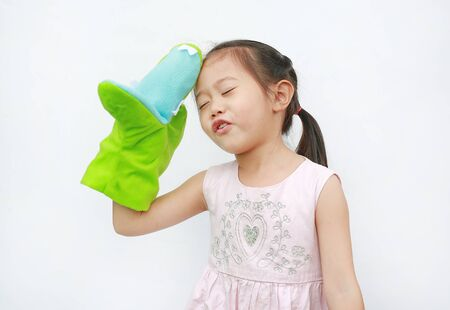 Adorable little Asian child girl hand wear and playing Crocodile puppets on white background.