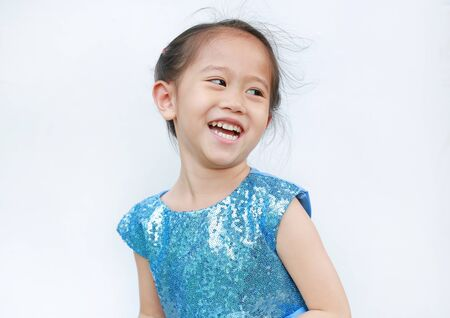 Portrait of happy child girl in shine blue dress on white background.