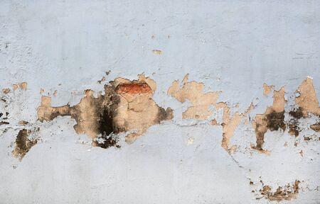 Peeling paint on a cement wall surface Banco de Imagens
