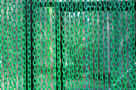 Green Plastic Chains curtain as background. Banco de Imagens