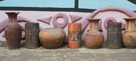 Old style clay jar in the garden. Garden decoration.
