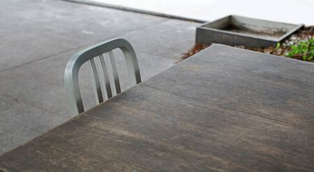 Empty wooden table and aluminium chair. Stok Fotoğraf
