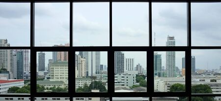 The interior of the buildings view of the city from the office windows.