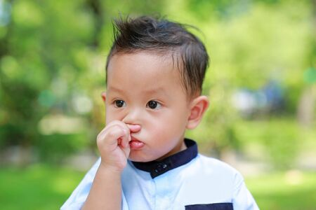 Asian baby boy used hand rub his nose because of itching.