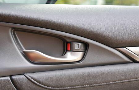 Detail of interior Car door handle Stock Photo