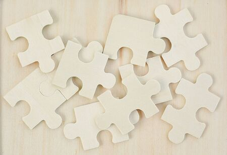 Wooden jigsaw piece on wood background