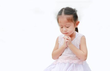 Close eyes little asian girl praying isolated on white background