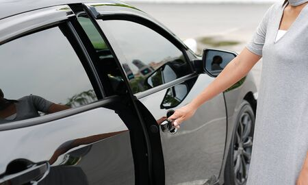 Close-up of woman hand opening a car door.