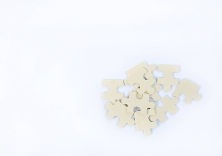 Wood jigsaw piece on wooden background with copy space Reklamní fotografie