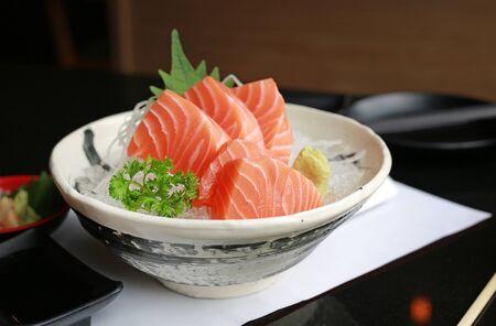 Delicious sashimi salmon on ice on the table. Stok Fotoğraf - 129761103