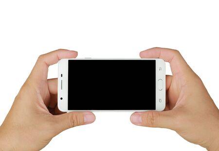 空白の画面で携帯電話のスマートフォンを保持する手。モバイル写真のコンセプト。白で隔離されています。