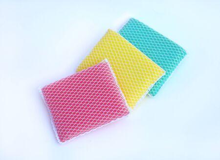 multi-colorful kitchen sponges for ware washing on white background Reklamní fotografie