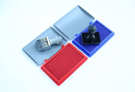 Rubber stamper and Red - Blue Ink cartridges on white background. Banque d'images