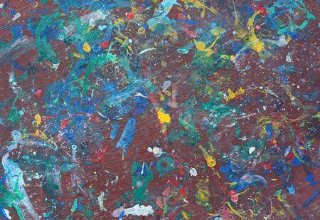 Fondo de textura de colores. Salpicaduras de color acrílico sobre la mesa de madera. Foto de archivo