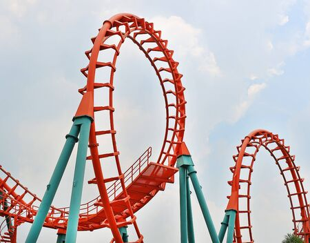 Roller coaster against cloud sky background. Stock Photo