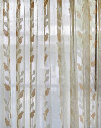 Transparent curtain fabric with flower pattern.