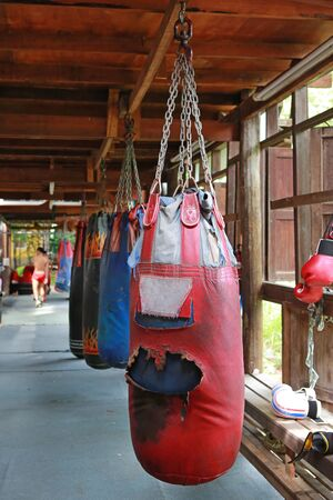Boxing sand bags hanging at a sports gym. Stock Photo