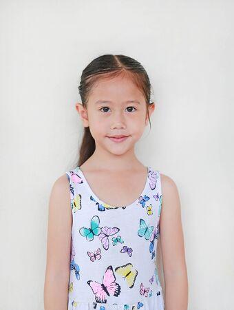 Pretty little Asian child  girl on white background. Portrait half-length.