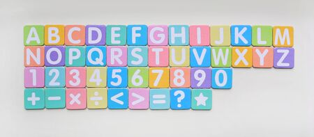 Multi-color Alphabet ABC letters and number and mathematics sign in square flat papers on white background.